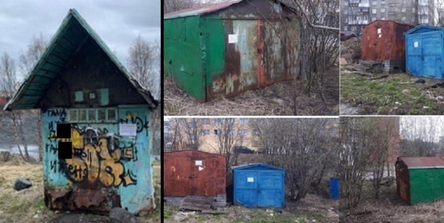 В Мурманске ищут владельцев строения на Семеновском и гаражей на Калинина